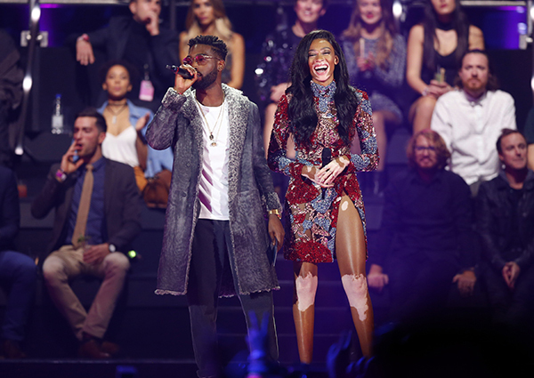 Copyright 2016 The Associated Press. All rights reserved. This material may not be published, broadcast, rewritten or redistributed without permission. Mandatory Credit: Photo by Peter Dejong/AP/REX/Shutterstock (7391406i) Tinie Tempah, left and Winnie Harlow present an award, during the MTV European Music Awards 2016, in Rotterdam, Netherlands Netherlands MTV EMA 2016, Rotterdam, Netherlands - 06 Nov 2016