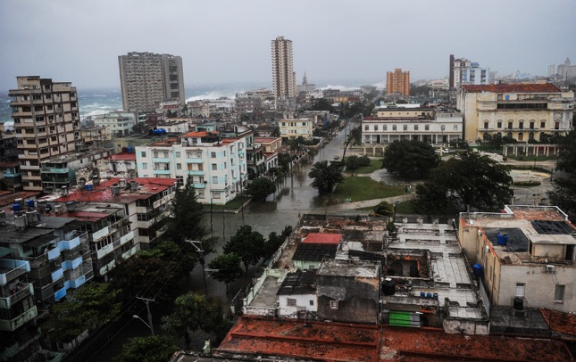 View of flooded streets in Havana during the passage of Hurricane Irma, on September 9, 2017.  Irma's blast through the Cuban coastline weakened it to a Category Three, but it is still packing winds of 125 miles (200 kilometer) per hour. / AFP PHOTO / YAMIL LAGE