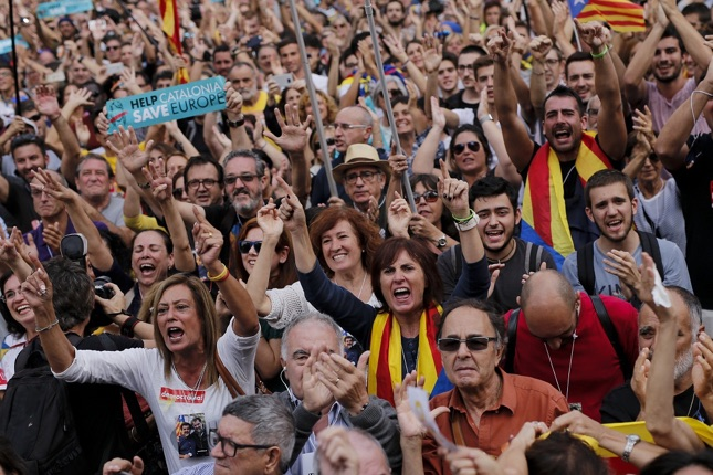 People celebrate after Catalonia's parliament voted to declare independence from Spain on October 27, 2017 in Barcelona.  Catalonia's parliament voted to declare independence from Spain and proclaim a republic, just as Madrid is poised to impose direct rule on the region to stop it in its tracks. A motion declaring independence was approved with 70 votes in favour, 10 against and two abstentions, with Catalan opposition MPs walking out of the 135-seat chamber before the vote in protest at a declaration unlikely to be given official recognition.  / AFP PHOTO / PAU BARRENA