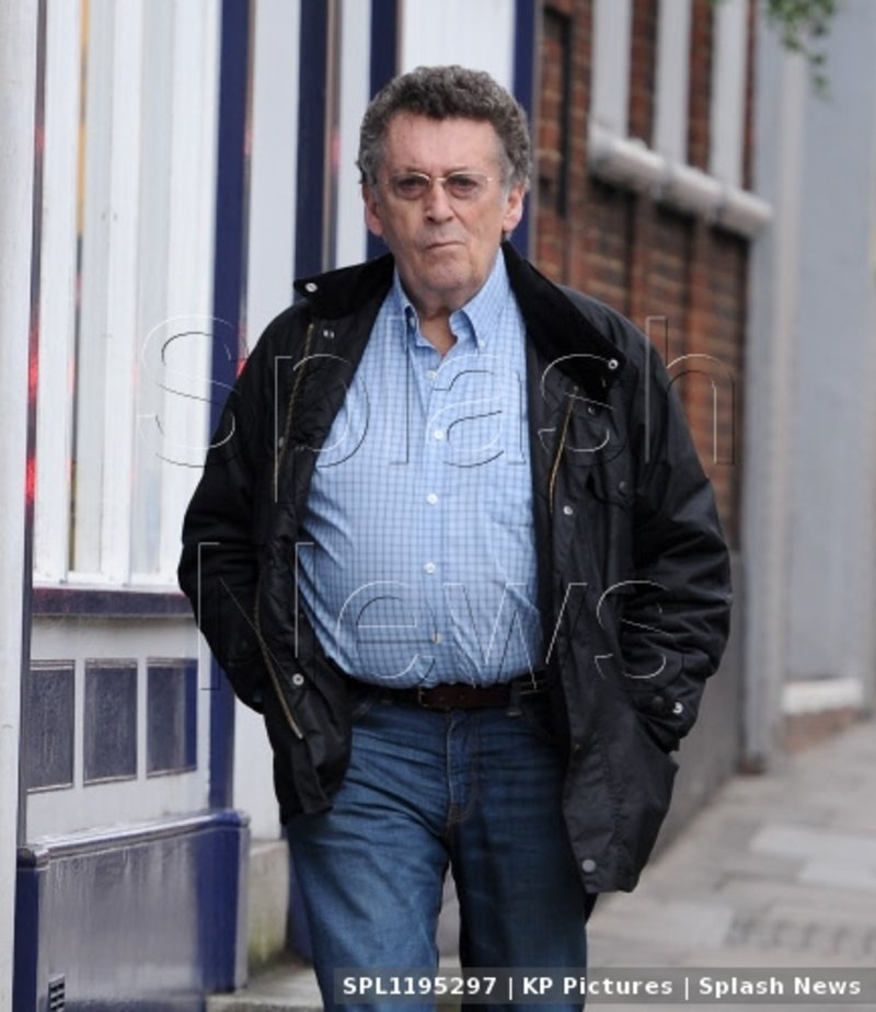 EXCLUSIVE: 9Robert Powell pictured leaving the bank this morning while out running errands in Highgate