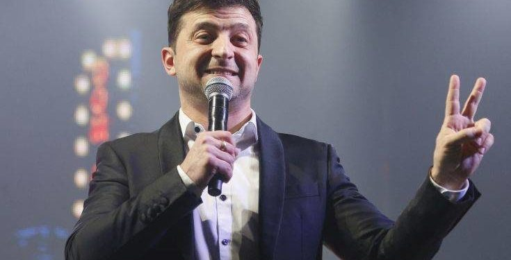 Volodymyr Zelenskiy, Ukrainian actor and candidate in the upcoming presidential election, hosts a comedy show at a concert hall in Brovary, Ukraine, Friday, March 29, 2019. Zelenskiy now surging ahead of both Tymoshenko and Poroshenko in the presidential context according to polls. (AP Photo/Efrem Lukatsky)