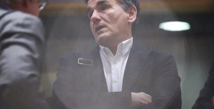 Greek Finance Minister Euclid Tsakalotos arrives to the Eurogroup Finance Ministers meeting at the European Council headquarters in Brussels, Monday, March 11, 2019. (AP Photo/Francisco Seco)