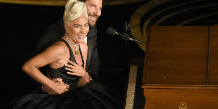 """Lady Gaga, left, and Bradley Cooper react to the audience after a performance of """"Shallow"""" from """"A Star is Born"""" at the Oscars on Sunday, Feb. 24, 2019, at the Dolby Theatre in Los Angeles. (Photo by Chris Pizzello/Invision/AP)"""