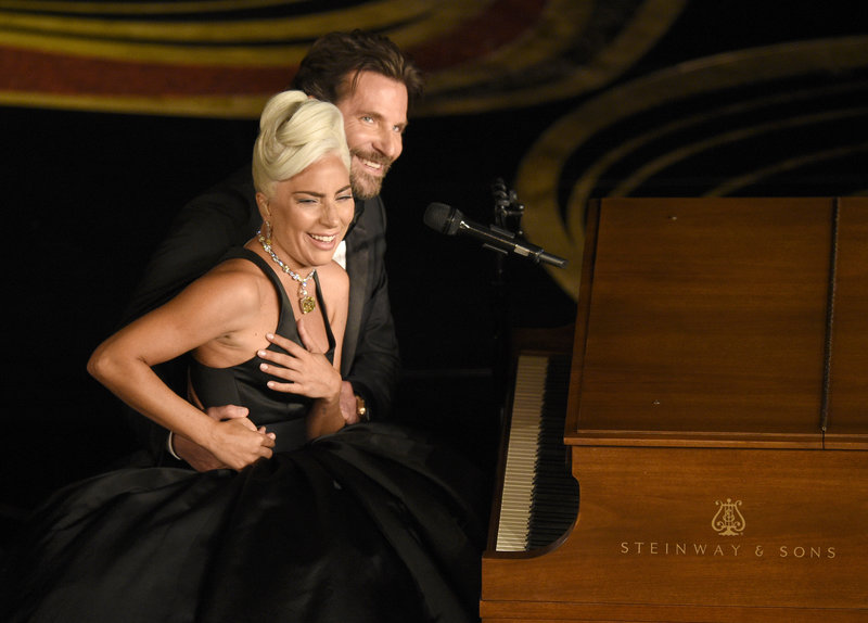 "Lady Gaga, left, and Bradley Cooper react to the audience after a performance of ""Shallow"" from ""A Star is Born"" at the Oscars on Sunday, Feb. 24, 2019, at the Dolby Theatre in Los Angeles. (Photo by Chris Pizzello/Invision/AP)"