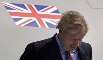 Britain's Prime Minister Boris Johnson arrives at the airport in Biarritz, France, for the first day of the G-7 summit, Saturday, Aug. 24, 2019. U.S. President Donald Trump and the six other leaders of the Group of Seven nations will begin meeting Saturday for three days in the southwestern French resort town of Biarritz. France holds the 2019 presidency of the G-7, which also includes Britain, Canada, Germany, Italy and Japan. (AP Photo/Peter Dejong)