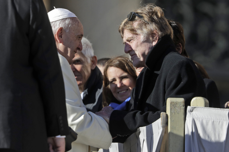 Pope Francis greets American actor, director and producer Robert Redford at the end of his weekly general audience, in St. Peter's Square, at the Vatican, Wednesday, Dec. 4, 2019. (AP Photo/Andrew Medichini)