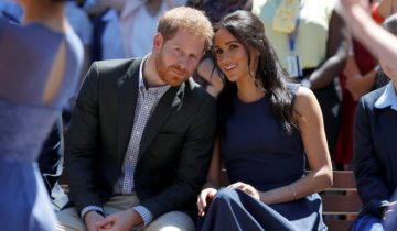 FILE PHOTO: Britain's Prince Harry and his wife Meghan, Duchess of Sussex, visit Macarthur Girls High School in Sydney