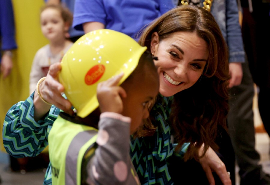 Britain's Kate Duchess of Cambridge reacts with a child, during the launch of a UK-wide survey on early childhood at Thinktank in the Birmingham Science Museum, Birmingham, England, Tuesday Jan. 21, 2020.  The major nationwide poll will be conducted on behalf of the Royal Foundation, aims to encourage a nationwide conversation on early childhood. (Eddie Keogh/PA via AP)
