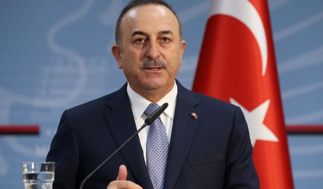 Turkish Foreign Minister Cavusoglu speaks during a news conference in Tirana