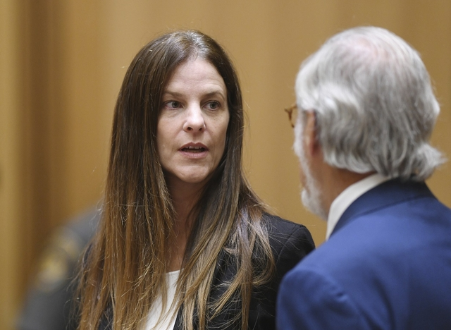 Michelle C. Troconis, 44, appears in court with her attorney Andrew Bowman in relation to her charges of tampering with or fabricating physical evidence and first-degree hindering prosecution, to which she has pleaded not guilty, at Connecticut Superior Court in Stamford, Conn. Monday, Aug. 19, 2019. The charges stem from video surveillance footage that police said shows two people resembling Troconis and Fotis Dulos making more than 30 stops in a four-mile stretch of Hartford the night of the disappearance of Dulos' wife, Jennifer. Police said the videos showed Fotis Dulos dumping bags that were later determined to contain clothing and cleaning supplies with his wife's blood, according to an arrest warrant.  (Tyler Sizemore/Hearst Connecticut Media via AP, Pool)
