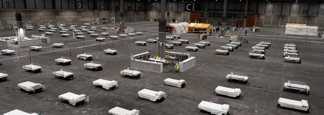 In this photo provided by Comunidad de Madrid, beds for COVID-19 patients are placed at IFEMA convention center in Madrid, Spain on Saturday, March 21, 2020. Spanish health authorities have acknowledged that some intensive care units in the hardest-hit areas are close to their limit. The army was building a field hospital with 5,500 beds in a convention center in Madrid, where hotels are also being turned into wards for virus patients without serious breathing problems. (Comunidad de Madrid via AP)