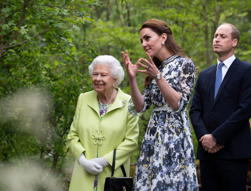 Britain's Queen Elizabeth II visits the 'Back to Nature' garden with Prince William and Kate, Duchess of Cambridge at the RHS Chelsea Flower Show at the Royal Hospital Chelsea, London, Monday May 20, 2019. (Geoff Pugh/Pool via AP)