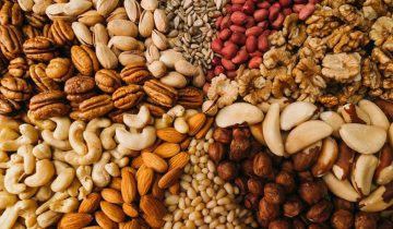bigstock-nuts-mix-in-a-canvas-bag-in-ta-235549504