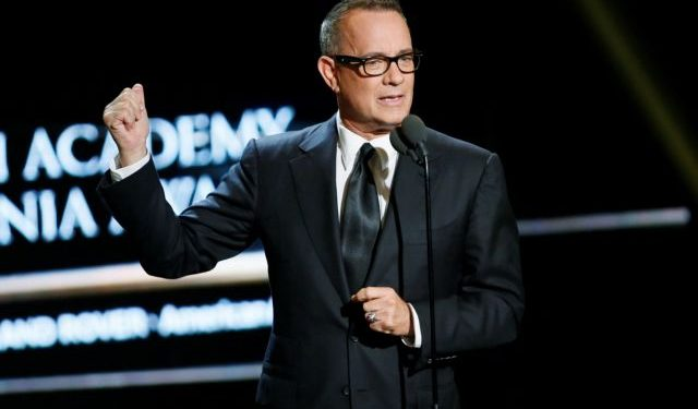 Actor Tom Hanks presents actress Felicity Jones the British Artist of the year award at the British Academy of Film and Television Arts (BAFTA) Los Angeles' Britannia Awards in Beverly Hills