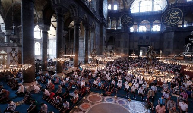Worshippers attend the noon prayer on the eve of the Muslim festival of Eid al-Adha at Hagia Sophia Grand Mosque in Istanbul
