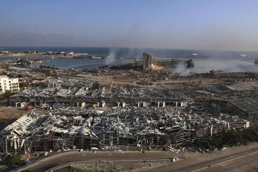 This photo shows a general view of the scene of an explosion that hit the seaport of Beirut, Lebanon, Wednesday, Aug. 5, 2020. A massive explosion rocked Beirut on Tuesday, flattening much of the city's port, damaging buildings across the capital and sending a giant mushroom cloud into the sky. (AP Photo/Bilal Hussein)
