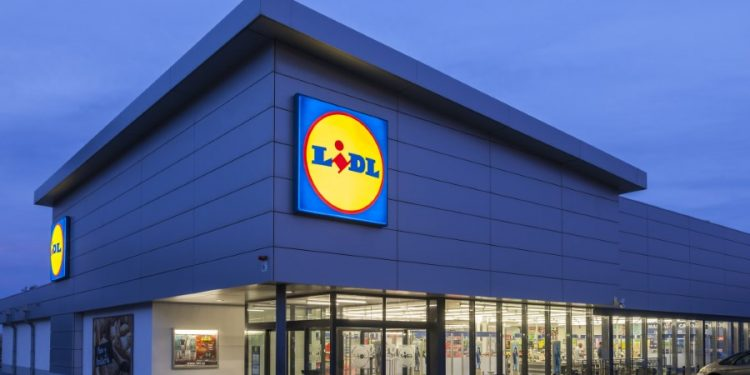 Cartagena, Spain - May 17, 2017: New Lidl supermarket building illuminated at dusk. Lidl is german discount supermarkets chain based in Neckarsulm, Germany