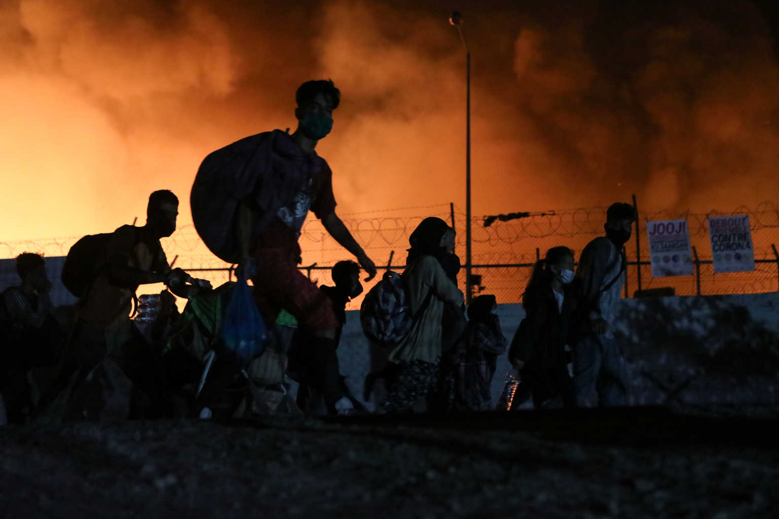 Fire burns at the Moria camp for refugees and migrants on the island of Lesbos