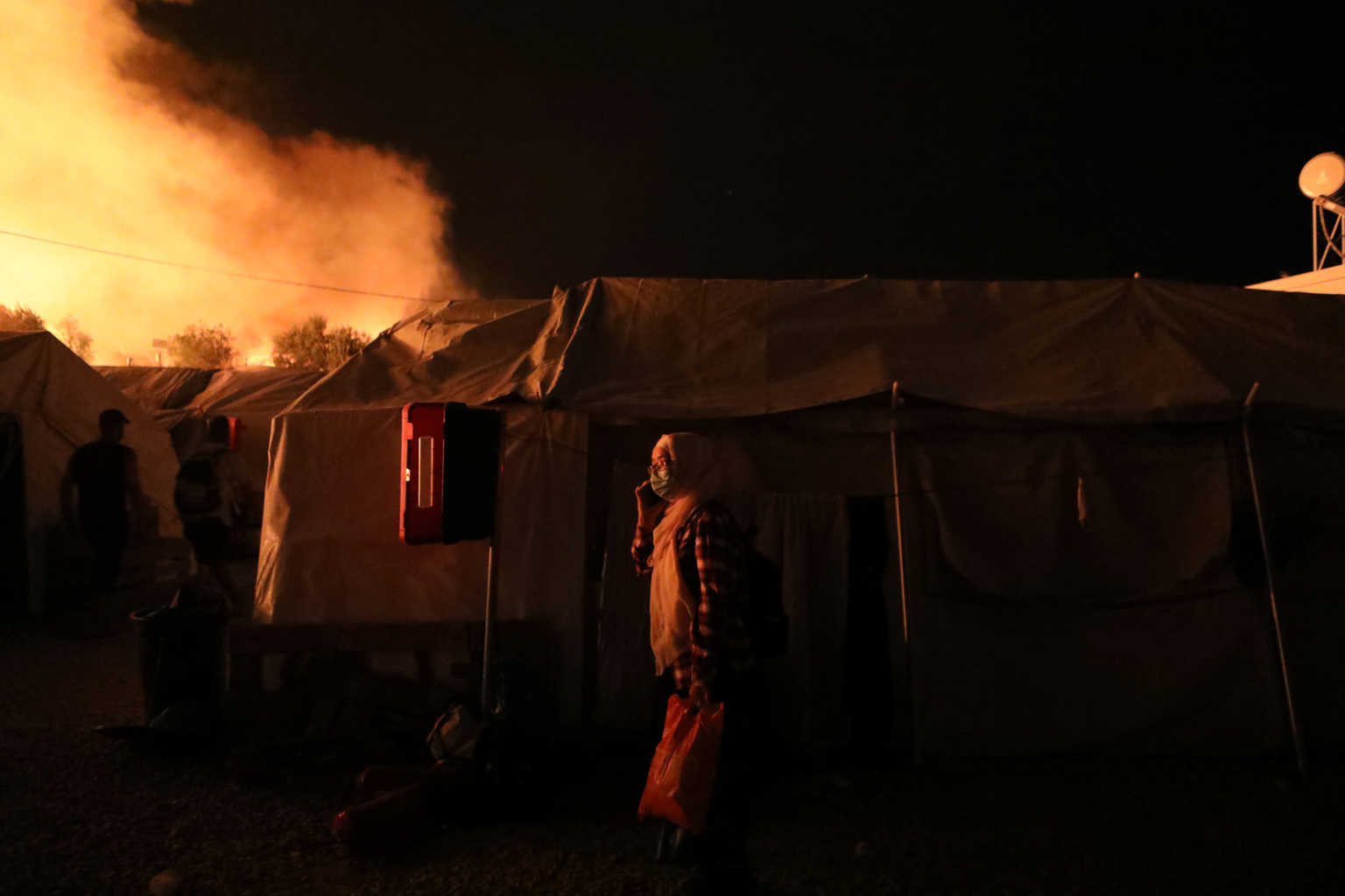 Flames rise as a fire burns at the Moria camp for refugees and migrants on the island of Lesbos