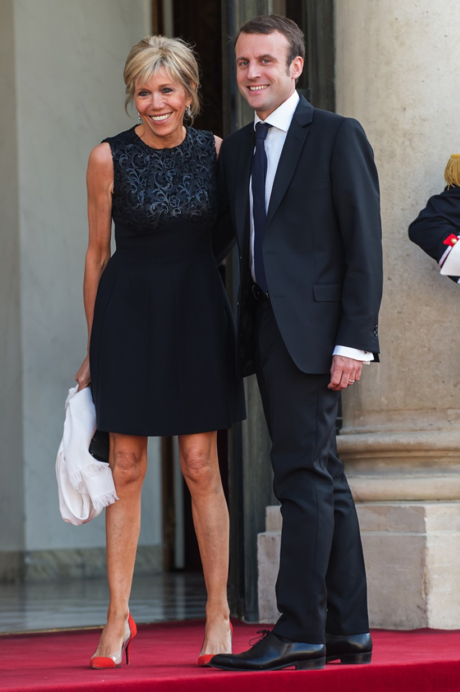 France's Economy Minister Emmanuel Macron and his wife Brigitte Trogneux pose for photographers as they arrive at the Elysee Palace in Paris, France, Tuesday, June 2, 2015. (AP Photo/Kamil Zihnioglu)