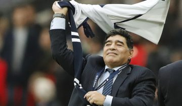Argentina soccer legend Diego Armando Maradona waves a shirt during halftime of the English Premier League soccer match between Tottenham Hotspur and Liverpool at Wembley Stadium in London, Sunday, Oct. 22, 2017.(AP Photo/Frank Augstein)