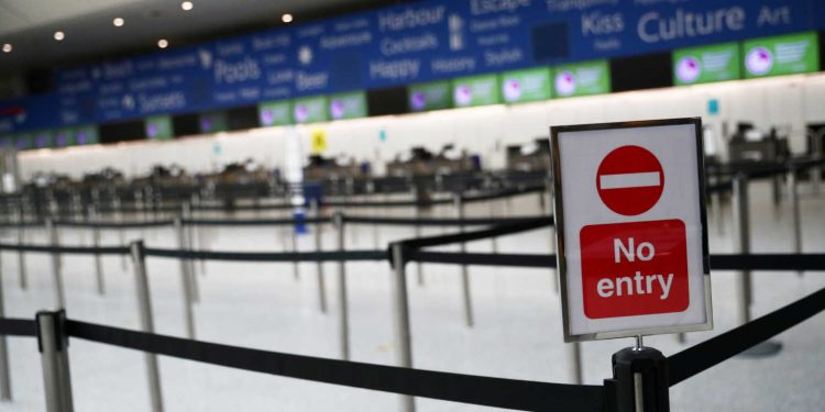 FILE PHOTO: General view of an empty British Airways check in desk area at an empty Gatwick airport, as the spread of the coronavirus disease (COVID-19) continues, Gatwick, Britain, May 5, 2020. REUTERS/Hannah McKay/File Photo