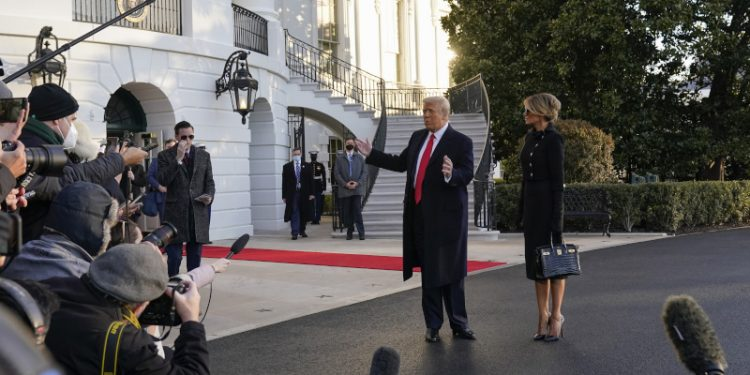 President Donald Trump and first lady Melania Trump stop to talk with the media as they walk to board Marine One on the South Lawn of the White House, Wednesday, Jan. 20, 2021, in Washington. Trump is en route to his Mar-a-Lago Florida Resort. (AP Photo/Alex Brandon)