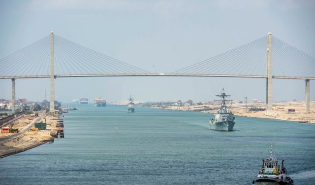 The guided-missile cruiser USS Monterey (CG 61), left, and the guided-missile destroyer USS Thomas Hudner (DDG 116) sail behind the aircraft carrier USS Dwight D. Eisenhower (CVN 69) during a Suez Canal transit
