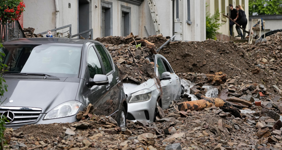 Cars are covered in Hagen, Germany, Thursday, July 15, 2021 with the debris brought by the flooding of the 'Nahma' river the night before. People have died and dozens of people are missing in Germany after heavy flooding turned streams and streets into raging torrents, sweeping away cars and causing some buildings to collapse. (AP Photo/Martin Meissner)